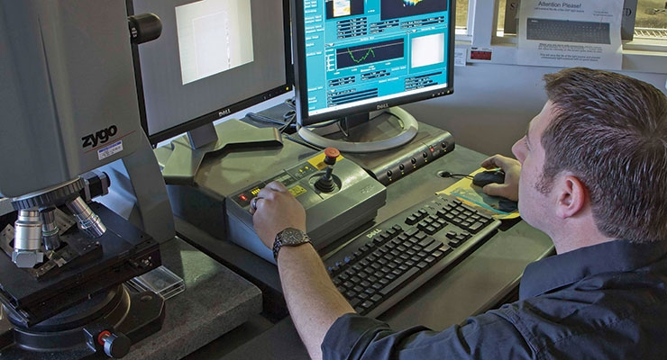 A mechanical engineer testing and measuring prototype parts in the IncisionLab. (Courtesy of Cadence Inc.)