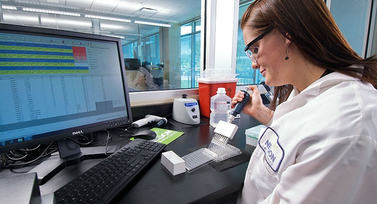 An analyst performs the Bacterial Endotoxin Test (BET).