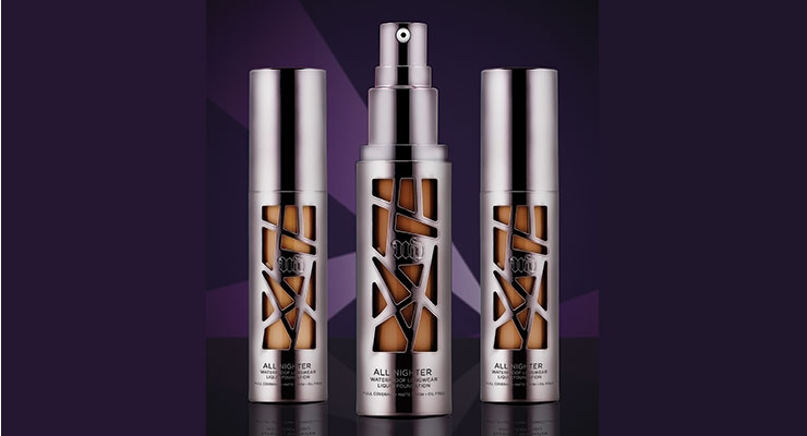 Urban Decay's All Nighter foundation was executed by Fusion Packaging to have a highly UV metallized, gunmetal effect with asymmetric cutouts to let the formula shade show through.