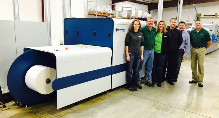 With the Domino press at the Green Bay facility, from left: Kristin Helms, Shane Magle, Roxanne Beth, Allen Hallberg, Glen Herlitz and Scott Fisher.