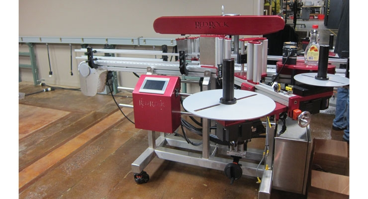 The company manufactures custom label application machinery.