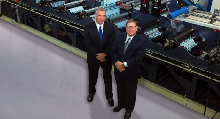 Control Group owners Bill Cheringal (left) and Jeff Levine (right) with their latest Nilpeter press.