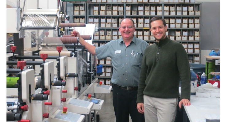 Ken Jones (L) and Brian Beam stand with Liberty's new Nilpeter press.