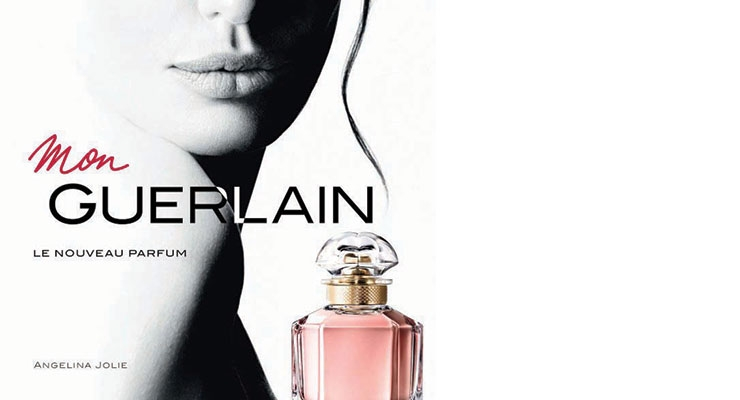 The print campaign uses two black-and-white images of the multi-dimensional Jolie with the multifaceted flacon.