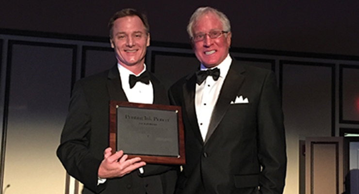 Jack Powers, right, of Sun Chemical accepts NAPIM's Pioneer Award from NAPIM president Pat Carlisle.
