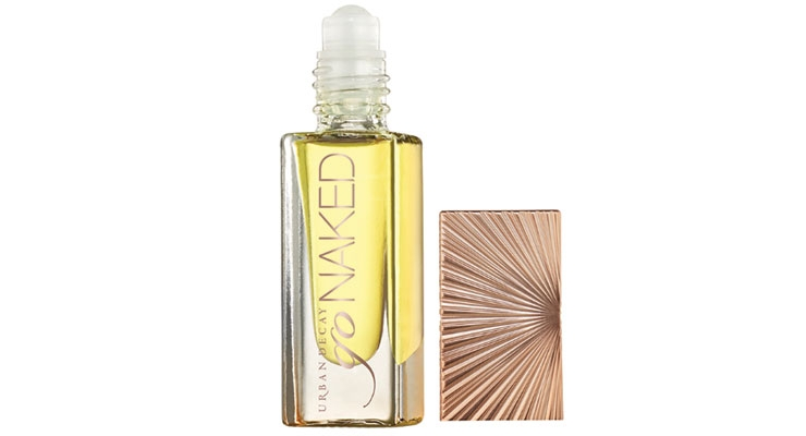 "Go Naked: Urban Decay selected a ""perfect for your purse"" clear bottle with a champagne-colored base and custom cap."