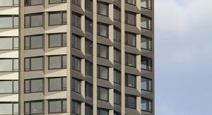 Beckers' BeckryFluor Coats 262-Foot Limmat Tower in Switzerland