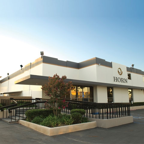 Horn opens new corporate facility