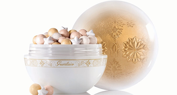 Guerlain's Météorites Flocons Enchantés is housed in an elegant jar produced by Cosmogen.