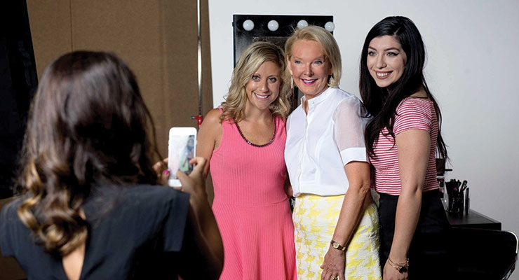 Avon representatives with Betty Palm, US president, social selling (center).