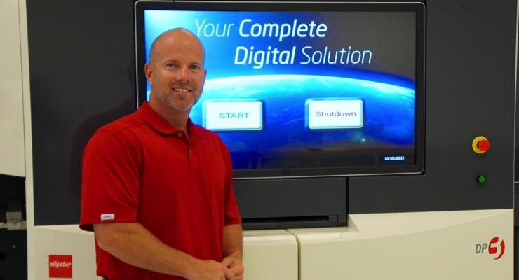 Keith Nagle, Digital Product Manager, Nilpeter USA Inc., in front of the DP-3 at the Nilpeter Technology Center in Cincinnati.