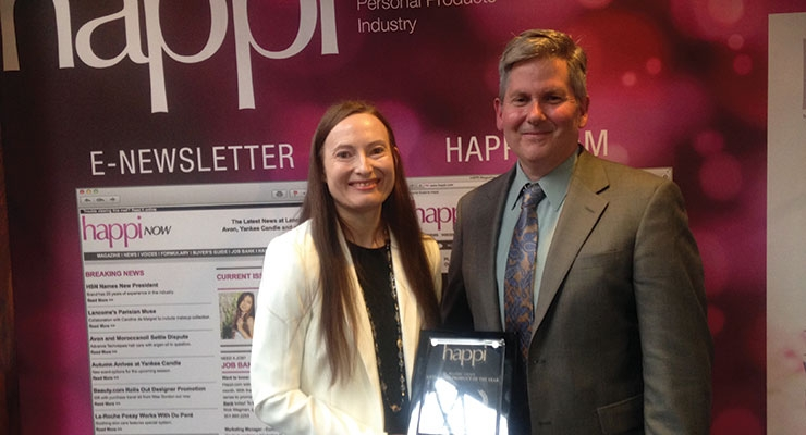 Helen Knaggs accepts the award from Tom Branna  at Happi's Anti-Aging Conference & Tabletop Exhibition last month in New Brunswick.