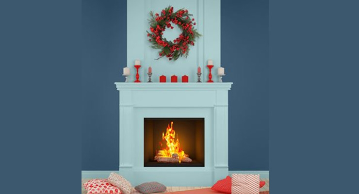 Make holiday trimmings pop by painting the fireplace mantel an unexpected colour such as Icy Fjord (6158-31) blue by SICO paint, surrounded by the brand's Meteor Shower (6020-63) blue, featured on the surrounding wall.