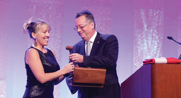 An orderly transfer of power. New IFSCC President Amy Wyatt accepts the gavel from 2015-2016 President Philippe Auderset.