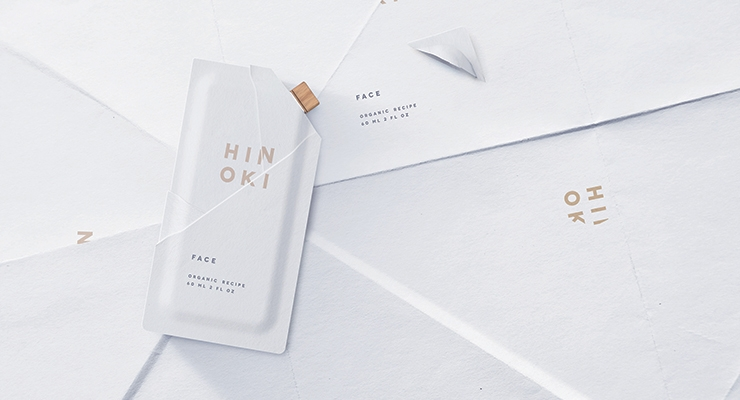 BillerudKorsnäs' innovation and design agency, NINE, was awarded Pentawards' Bronze for its renewable packaging for organic beauty products. Each origami-inspired container consists of a single sheet that is folded and pressed into shape; a tear-off corner reveals a wood twist cap. Hinoki is a range of travel-sized, organic skin care products in biodegradable paper containers.