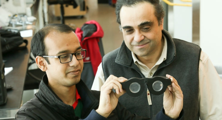 "University of Utah electrical and computer engineering professor Carlos Mastrangelo, right, and doctoral student Nazmul Hasan have created ""smart glasses"" with liquid-based lenses that can automatically adjust the focus on what a person is seeing, whether it is far away or close up. (Credit: Dan Hixson/University of Utah College of Engineering)"