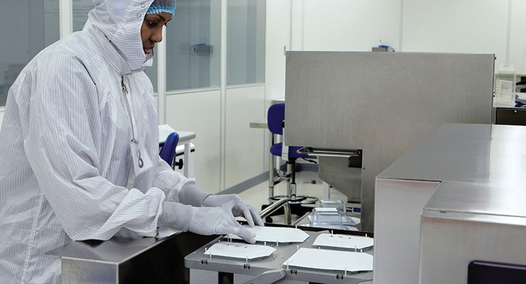 Cleanroom operator seals samples for a sterilization validation. Image courtesy of Millstone Medical Outsourcing.