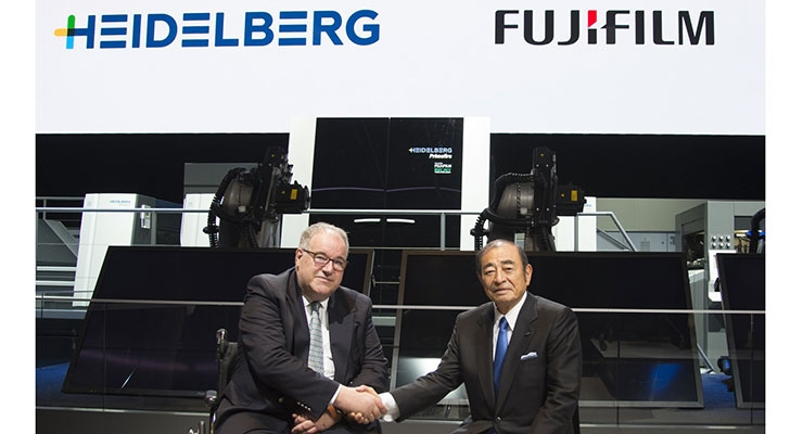Fujifilm chief executive Shigetaka Komori, right, and Heidelberg chief executive Dr. Gerold Linzbach meet at drupa 2016 during the world premiere of the Heidelberg Primefire 106 powered by FUJIFILM Inkjet Technology.