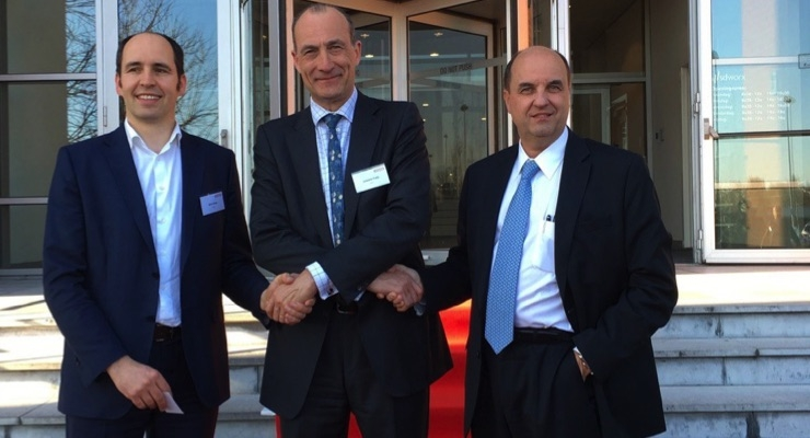 Wim Maes (L) exchanges handshakes with Antoine Fady and Benoit Chatelard (R).