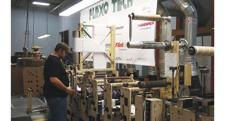 A Flexo Tech student learning on a Mark Andy 2200 8-color press.
