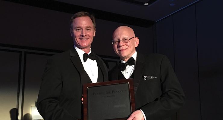 Luigi Ribaudo, right, of Sun Chemical, accepts NAPIM's Pioneer Award from NAPIM president Pat Carlisle.