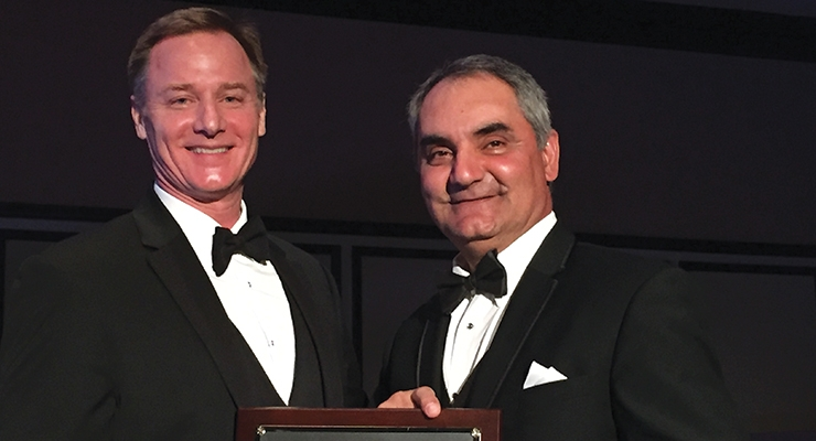 Ami Youhana, right, of Sun Chemical, accepts NAPIM's Pioneer Award from NAPIM president Pat Carlisle.