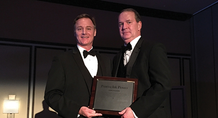 Dave Waller, right, of INX International Ink Co., accepts NAPIM's Pioneer Award from NAPIM president Pat Carlisle.