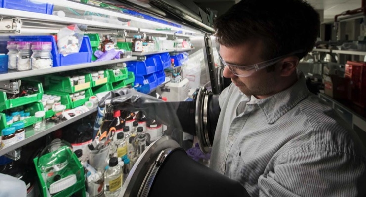 NREL researcher Dan Kroupa performs ligand exchanges on PbS quantum dot samples. (Photo by Dennis Schroeder, NREL)