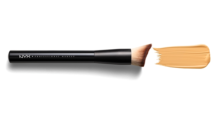 The Total Control Foundation Brush from NYX curves slightly inward, allowing it to fit around the natural curves of the face and into hard-to-reach spots.