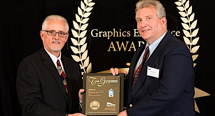 John LeCloux presenting the award to Mike Crownover, Glenroy Graphics engineer.