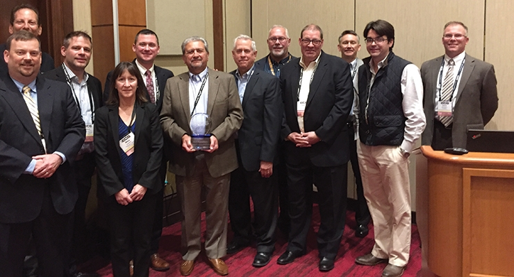 Members of the Eastern Coatings Show board of directors honored Rick Mazzarello, president  of Enrichem Specialties with a Lifetime  Achievement Award.