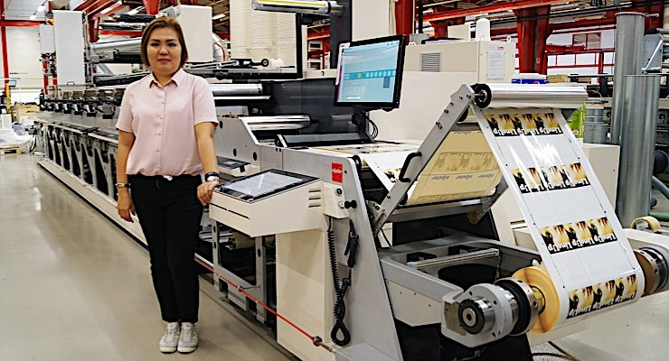Ann Chua, general manager of Allied Pacific Packaging Solutions Corporation, in front of the new Nilpeter FA-4*.
