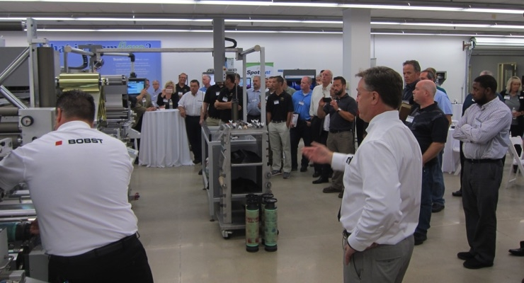 The crowd gathers for the Bobst M1 press demonstration.