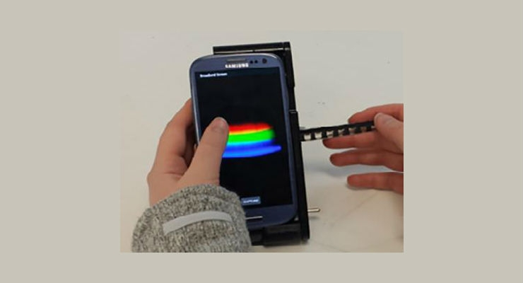 The spectral transmission-reflectance-intensity (TRI)-Analyzer attaches to a smartphone and analyzes patient blood, urine, or saliva samples as reliably as clinic-based instruments that cost thousands of dollars. Image courtesy of Department of Bioengineering, University of Illinois at Urbana-Champaign.