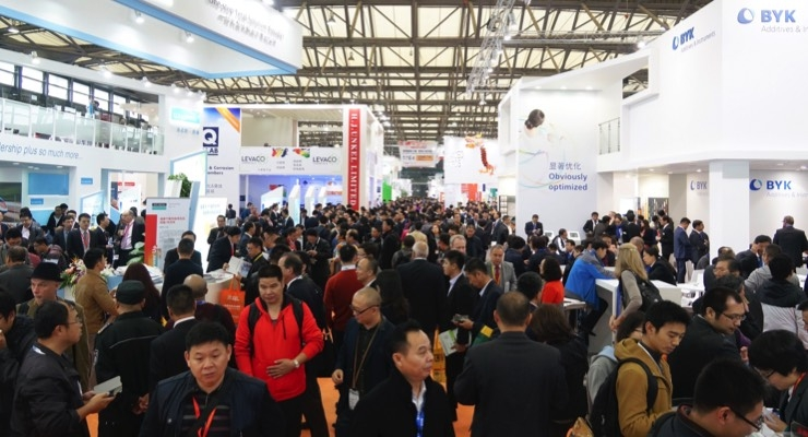 Attendees gather information during CHINACOAT 2016 in Guangzhou.