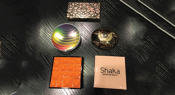 At Libo, deco effects created looks including a rainbow effect—such as the one on this floral-shaped compact.