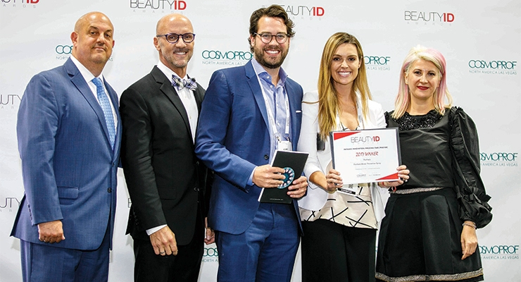 PreHeels accepts the award for Package Innovation: Personal Care-Prestige. (L-R): Jay Gorga, Eric Horn, Adam Kolom, co-founder & CEO, PreHeels, Dana Ward, co-founder & CMO, PreHeels; Daniela Ciocan