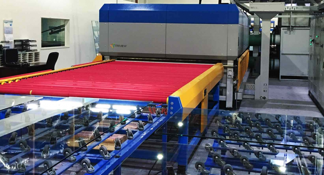 Glass tempering furnace at Triview Glass Industries, producing fully tempered and heat strengthened glass, up to five times stronger and safer than untreated products. (Photo: SolarWindow)