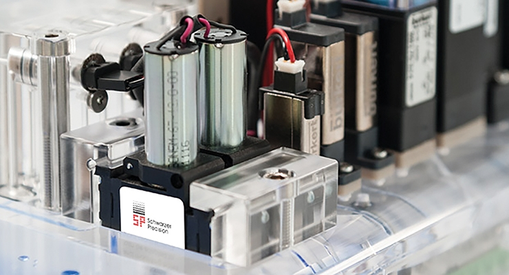 Pumps and solenoid valves on a bond acrylic manifold. Image courtesy of Bürkert Fluid Control Systems.
