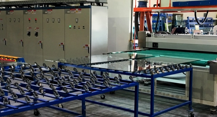 Glass moves to tempering machine after horizontal wash at Triview Glass. (Source - SolarWindow)