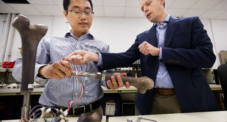 Dr. Jerome Lynch (right), an engineering professor at the University of Michigan, discusses the results of an experiment with research fellow Wentao Wang. The Office of Naval Research is sponsoring Lynch