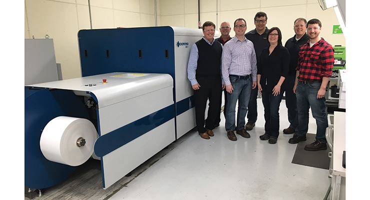 The Outlook Group team with its new Domino N610i UV inkjet press