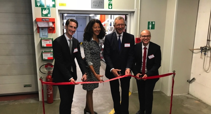 From left, Jens Adrio, head of corporate development; Veronique Danois, president of Siegwerk France; CEO Herbert Forker; and Matthieu Carni, business development manager; open the new production facility for inkjet inks in Annemasse, France. (Source: Siegwerk)