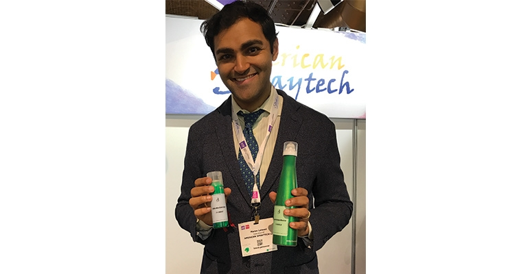American Spraytech's executive VP Manav Laiwani holding a few of their cans featuring spray and mist dispensers.