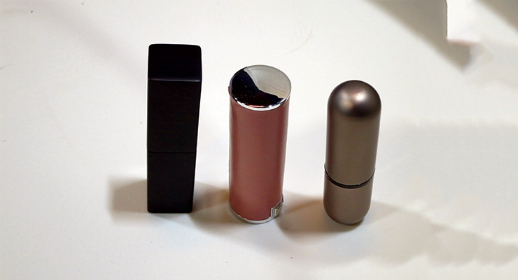 New lipstick packaging at Cosfinity includes a rounded, capsule-like aluminum tube that's weighted and a tube with a magnetic cap.