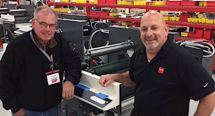 Greg Phipps of Phipps Label Co. and Bob Loescher of Nilpeter standing by the new FA on the assembly line at Nilpeter USA in Cincinnati, OH.