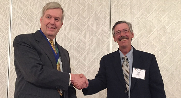 John Foster, left, of Cabot receives the Technical Associate Member Service Award from NPIRI president Dan Delegge.