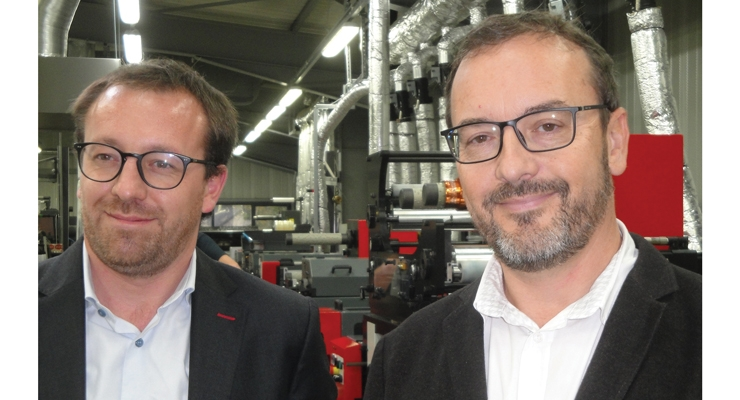 Benoît Demol, CEO of Codimag (L) and Arnold Derégnaucourt, CEO of Imprimerie Billet, stand in front of the Codimag label press.