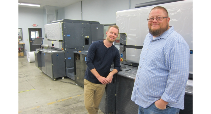 Andrew Boyd (left), president of Blue Label Digital Printing, and Joe Schorr, director of operations, with their newest press – an HP Indigo 8000. The 262 fpm digital press was purchased at Labelexpo Europe 2017.