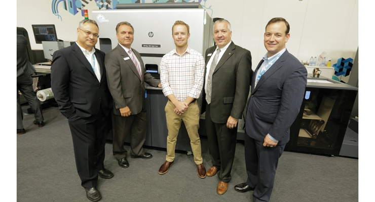 Andrew Boyd (center), president of Blue Label Digital Printing, with staff of HP Indigo at Labelexpo, where Boyd signed off on the press purchase.